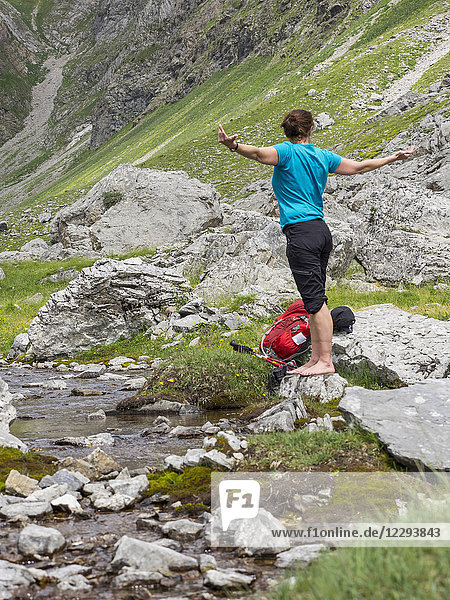 Woman hiker standing at the riverbank  Gavarnie  France