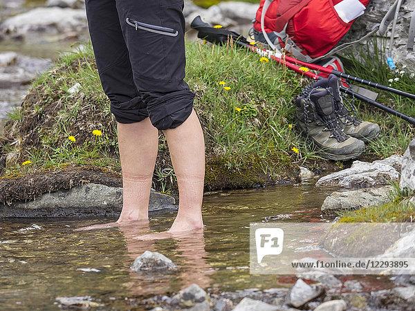 Woman hiker standing in water at riverbank  Gavarnie  France