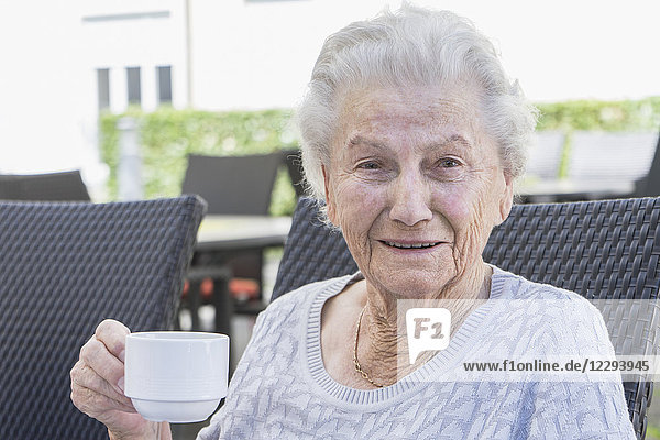 Portrait of senior woman having coffee
