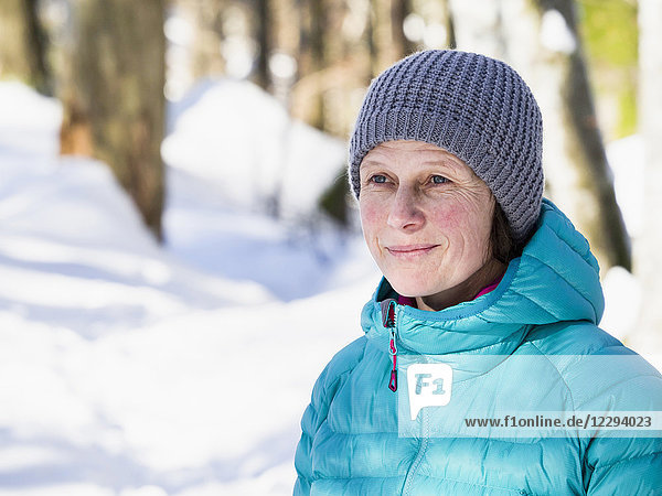 Woman hiking through snowy forest in Valley of Yach  Elzach  Black Forest  Baden-Württemberg  Germany