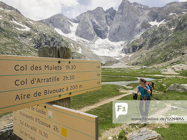 Woman hiking in the High Pyrenees in front of mount Vignemale  Cauterets  France