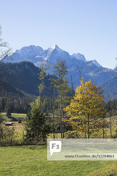 Scenic view of autumn landscape and snowcapped mountain in Bavarian alps  Alpspitz  Wetterstein Mountain