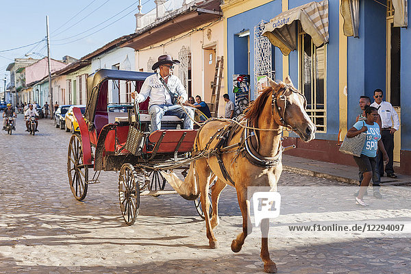 Man riding on horse cart in Trinidad old town  Cuba