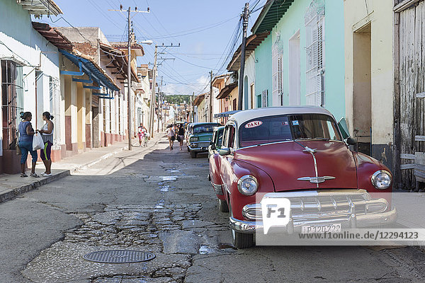 Old cars on street of Trinidad old town  Cuba