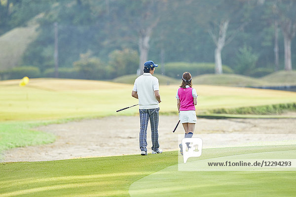 Japanese golf players on course