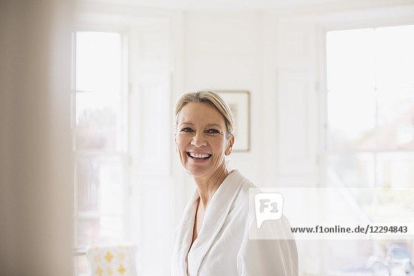 Portrait smiling  confident mature woman in bathrobe