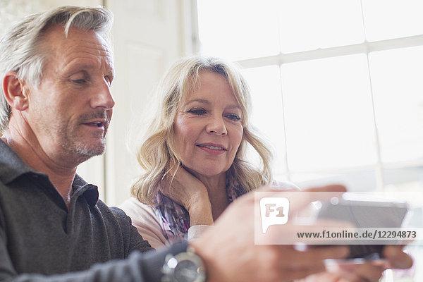 Mature couple using smart phone