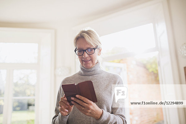 Mature woman reading diary