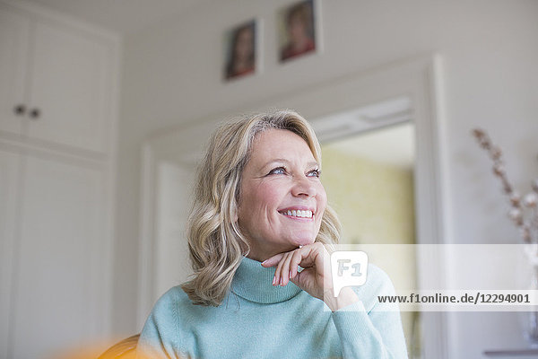 Smiling  ambitious mature woman looking away
