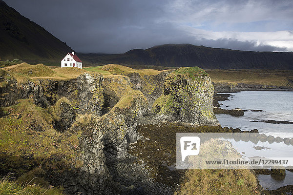 Remote house on craggy  remote cliff  Arnarstapi  Snaefellsnes  Iceland
