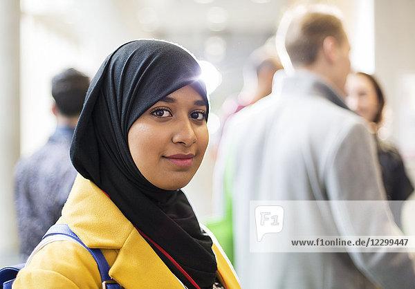 Portrait smiling  confident businesswoman wearing hijab