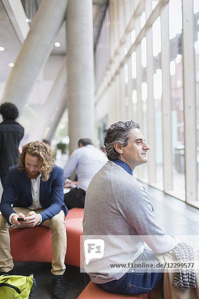 Confident businessman at conference Confident businessman at conference