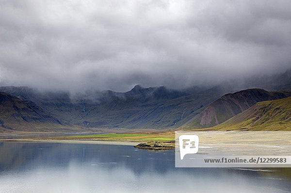 Clouds over remote landscape and water  Iceland