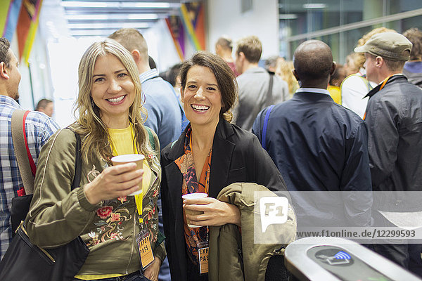 Portrait smiling  confident women drinking coffee at conference