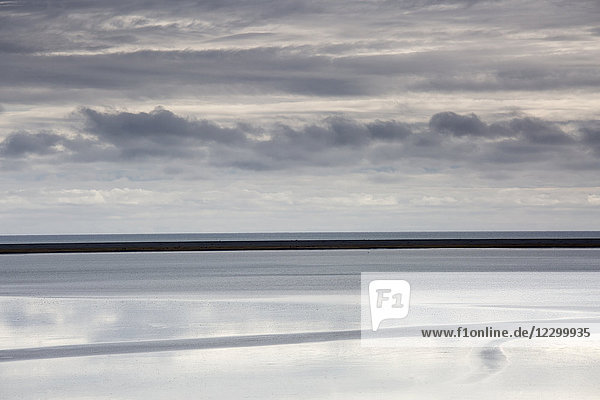 Tranquil  blue and gray clouds and ocean  Lagoon  Hofn  Iceland