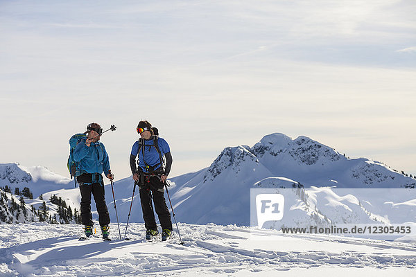Front view of two men cross-country skiing in North Cascades National Park  Washington State  USA