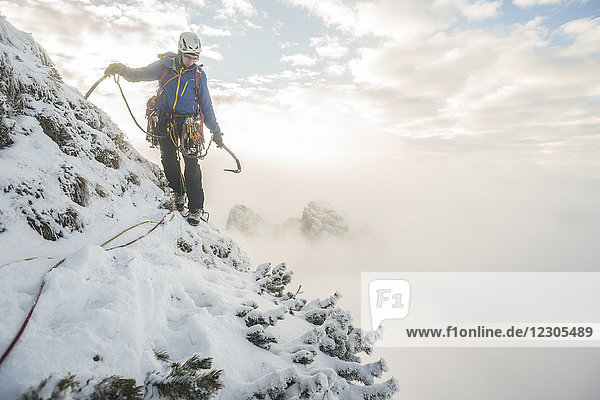 Lone male mountain climber in winter in Tatra Mountains  Malopolskie Province  Poland