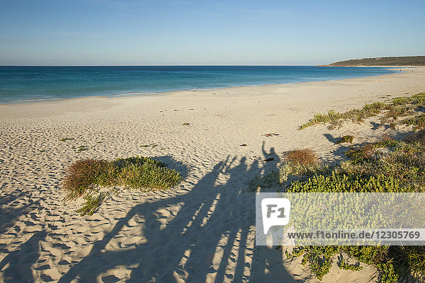 Scenery with shadow of family at beach of Geographe Bay  Cape Naturaliste  Western Australia