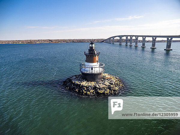 View of lighthouse in sea and bridge in background  Narragansett Bay  North Kingstown  Rhode Island  USA