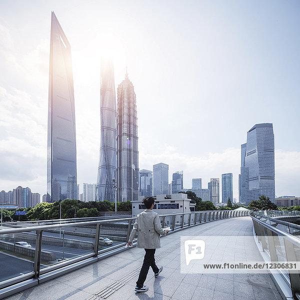 China  Shanghai  Skyline  man on footbridge