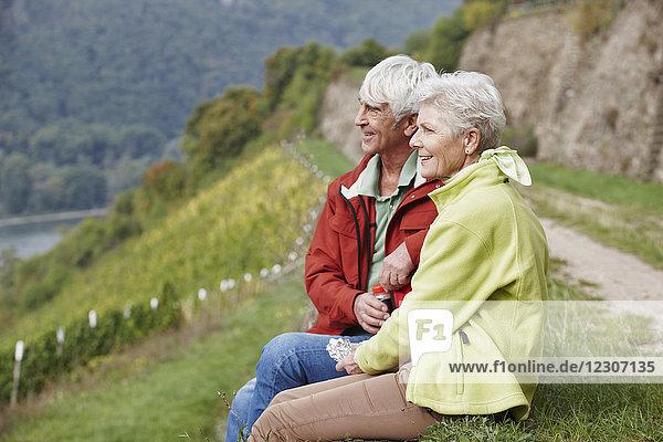 Germany  Rheingau  hiking senior couple having a rest
