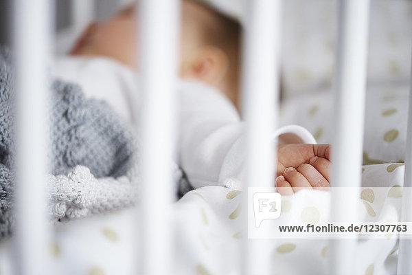Defocused shot of baby lying in crib Defocused shot of baby lying in crib