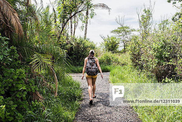 Young female tourist walking path near Victoria Falls  Zimbabwe  Africa