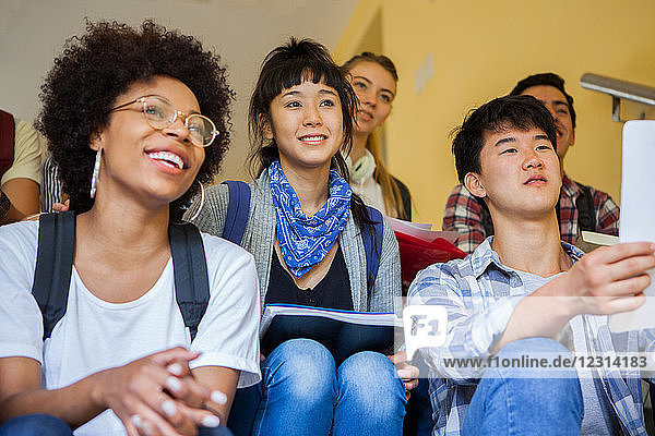 Group of college students studying on stairs