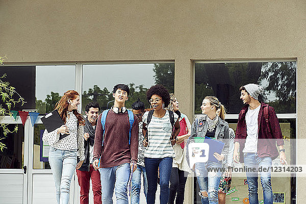 College students chatting while walking on campus