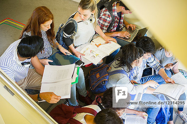 Group of students studying together in stairwell