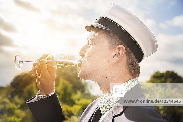 Young man drinking champagne