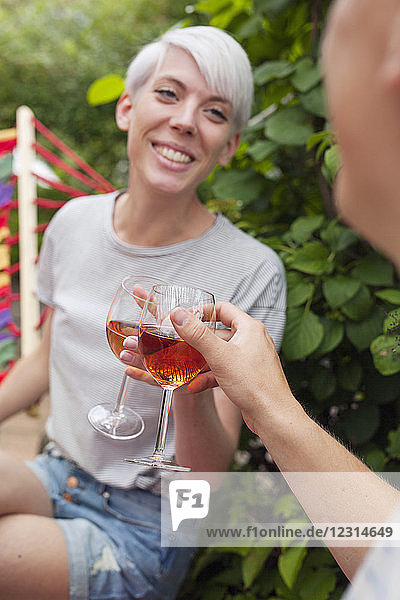 Couple raising toast in garden