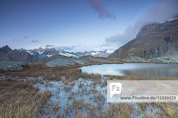 Alpine lake with Monte Disgrazia in the background  Alpe Fora  Malenco Valley  province of Sondrio  Valtellina  Lombardy  Italy  Europe
