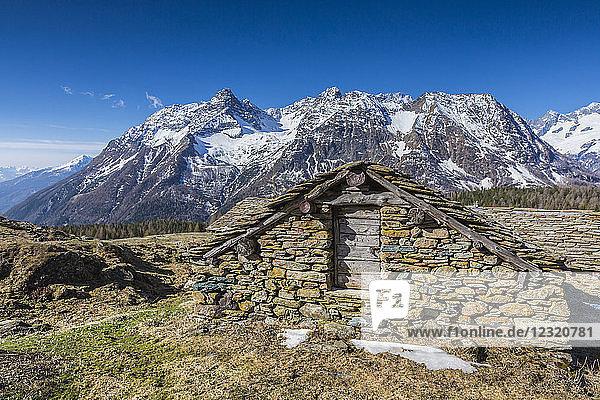 Stone hut  Entova Alp  Malenco Valley  province of Sondrio  Valtellina  Lombardy  Italy  Europe