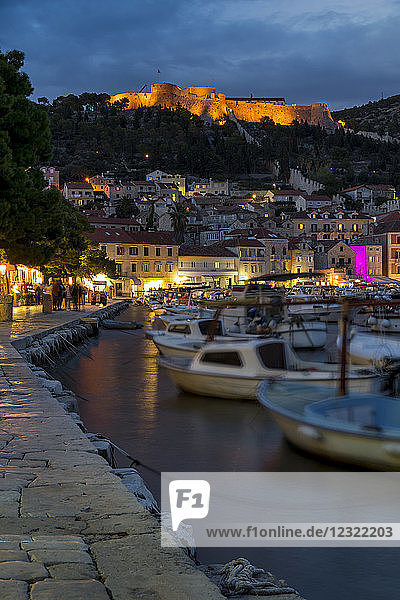 The port of Hvar Town and the Spanish Fortress at dusk  Hvar  Croatia  Europe