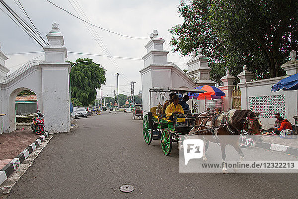 Horse and carriage on the streets of Yogyakarta  Java  Indonesia  Southeast Asia  Asia