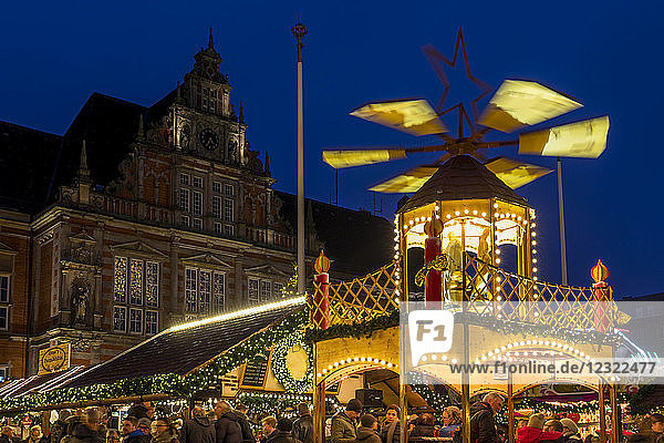 Christmas market at the town hall square at dusk in Harburg  a district of Hamburg  Germany  Europe