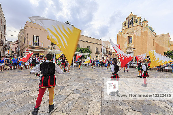 Traditional costumes and flags  Favignana island  Aegadian Islands  province of Trapani  Sicily  Italy  Europe