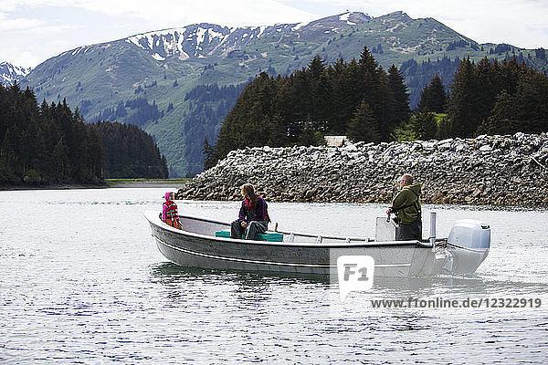 Family in their set-net skiff near Seldovia  South-central Alaska; Alaska  United States of America