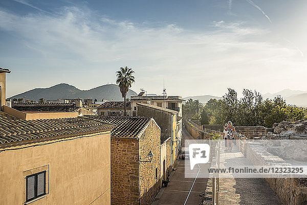Tourists walking over the city wall; Alcudia  Mallorca  Balearic Islands  Spain