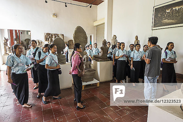 School girls in the Gallery of Khmer Art at the National Museum of Arts; Phnom Penh  Cambodia