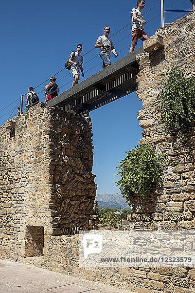 Tourists walking over the city wall; Alcudia  Mallorca  Balearic Islands  Spain