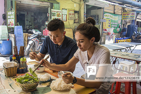 Couple enjoying a meal in the Old Quarter; Hanoi  Vietnam