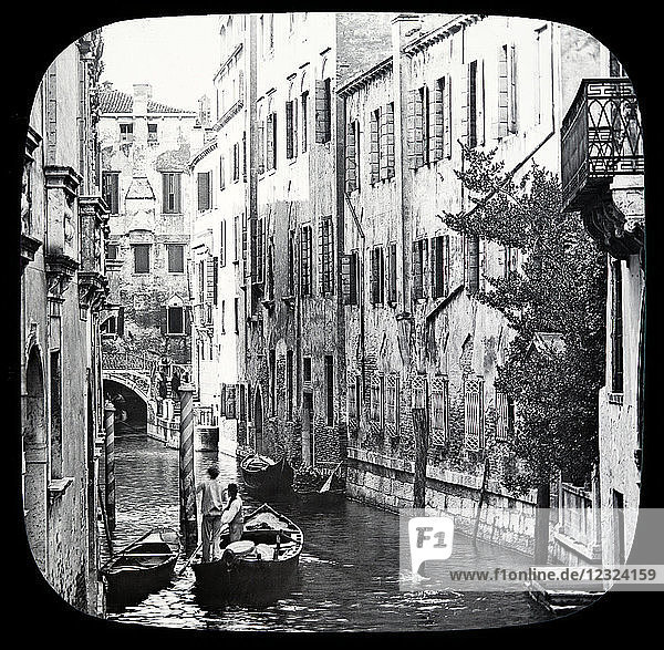 Magic lantern slide circa 1900.Victorian/Edwardian.Social History. The Beauties of Venice photographs created in 1888 Joseph John William ACWORTH F.I.C.  F.C.S.J. The Beauties of Venice . In Venice there is not a single horse  or any other beast of burden ; the canals are the water-streets  by means of which passengers and merchandize may be conveyed to any part of the city. The canal is the street and the gondola is the cab or carriage. Except in the Public Gardens there are not many trees to be found in Venice  though every here and there we meet with such an oasis in the barren desert of masonry as we see in the picture before us [B] Although there are such a number of canals in Venice  yet access to all and every part of the town