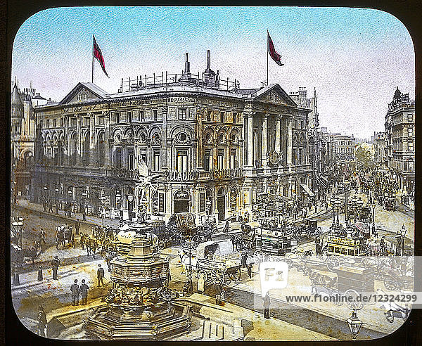 Magic Lantern slide circa 1900 hand coloured views of London  England in Victorian times. Piccadily Circus  very busy with trms coaches people.