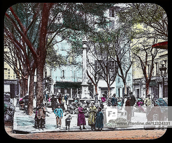 Magic Lantern slide circa 1900. Victorian or Edwardian era. The origional monchrome ( black and white ) photograph hand coloured.The photograph is the work of G.W. Wilson photographer and slide manufacturer 1823-1893.George Washington Wilson (7 February 1823 – 9 March 1893) was a pioneering Scottish photographer. The French Riviera and Monte Carlo (lecture ) Slide 14 Grasse market-place