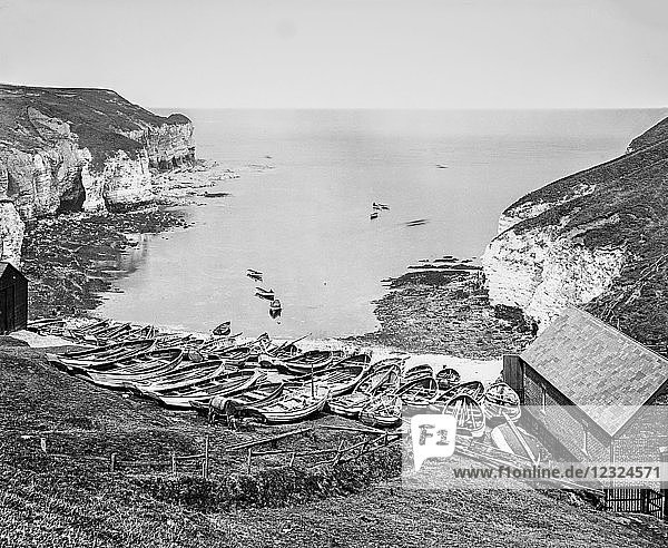 The photograph is the work of G.W. Wilson photographer and slide manufacturer 1823-1893. North Bay Flamborough Head   Fishing was first recorded in the 13th century  when about nine boats fished the seas off the Head. By the 1890s  some eighty 'cobles' were registered. George Washington Wilson (7 February 1823 – 9 March 1893) [1] was a pioneering Scottish photographer. From about 1870 onwards Wilson relied increasingly on others to add to his stock.[6] Thus all of the Mediterranean views and many of the English and Scottish series are the work of staff photographers  or were commissioned by the company from photographic firms elsewhere in the UK; and the Australian and South African images were added to the firm's stock in the 1890s by Charles Wilson (GWW's son) and staff photographers such as Fred Hardie.[7]