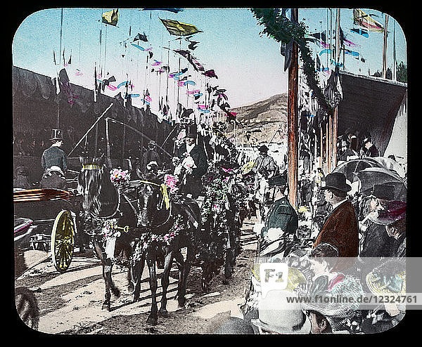 Magic Lantern slide circa 1900. Victorian or Edwardian era. The origional monchrome ( black and white ) photograph hand coloured.The photograph is the work of G.W. Wilson photographer and slide manufacturer 1823-1893.George Washington Wilson (7 February 1823 – 9 March 1893) was a pioneering Scottish photographer. The French Riviera and Monte Carlo (lecture ) . Slide 70 Battle of the flowers  Menton. Parade with horses  peopleand flags