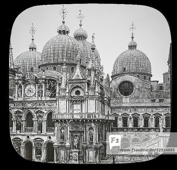 Magic lantern slide circa 1900.Victorian/Edwardian.Social History. The Beauties of Venice photographs created in 1888 Joseph John William ACWORTH F.I.C.  F.C.S.J. The Beauties of Venice. Courtyard of the Ducal Palace and the Cupolas of St. Mark's. The courtyard is embraced on our right  left  and behind by the Doge's Palace  and is faced by the colonnade through which we have just passed. Here we get a good idea of its interesting grouping of those Byzantine cupolas towering above the cathedral. The courtyard was begun at the close of the fifteenth century  but only partially completed. Its form is not symmetrical  owing to the previous existence of surrounding buildings°' In the courtyard are two bronze founts dating from 1566 and 1559 [B] magnificently decorated in relief with the figures and ornamental designs  and in remarkably fine preservation.