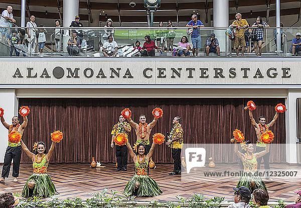 Hula dancers entertaining shoppers at the Ala Mona Shopping Center's stage in Waikiki; Honolulu  Oahu  Hawaii  United States of America